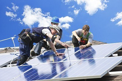 workers-installing-alternative-energy-photovoltaic-solar-panels-on-roof