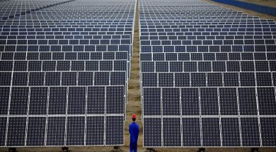 File photo of a worker inspecting solar panels at a solar farm in Dunhuang, 950km northwest of Lanzhou, Gansu Province