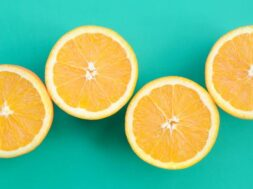 top-view-of-a-several-orange-fruit-slices-on-bright-background-in-turquoise-green-color-a-saturated_t20_wQv8Ar (1)
